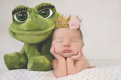 newborn baby girl with princess tiara and her frog awwwwwwww