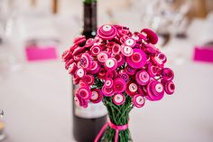 We made button flower bouquets for our table decorations. We wanted something a little different from the traditional flowers.