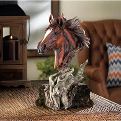 Dramatic style and fine detailing make this stallion sculpture a sure bet for enhancing the beauty of your room. The classical sculpture base gives way to a freeform driftwood sculpture thats topped by a spirited stallion bust.