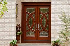 db-a252-dd Aurora fiberglass doors are made to look and feel like solid wood, without any of the maintenance. Craftsman style door shown is displayed with two full glass sidelights, and decorative glass.