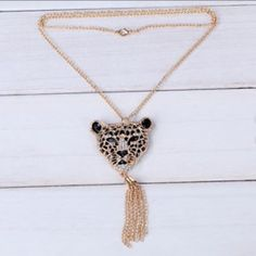"""Leopard Tassel Necklace Elegant looking leopard necklace with CZ stones. Gold plated zinc alloy. Chain is about 28"""". Tassel is about 2 1/2"""" long. New in package. Jewelry Necklaces"""