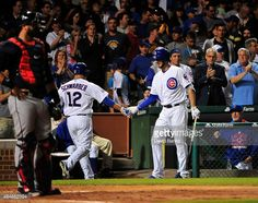 cubs beat braves august 20, 2015 | Kyle Schwarber #12 of the Chicago Cubs is greeted by Kris Bryant #17 ...