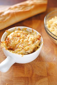 French Onion Soup  4 yellow onions 1 stick butter 1 tbs. tyme 3 cloves garlic 1tbs. salt 1/2 ts. peper 32 oz beef stock 1 cup chicken stock pinch of sugar
