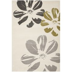 Anchor your living room seating group or define space in the den with this lovely rug, featuring a bold floral motif.   Product: Rug...