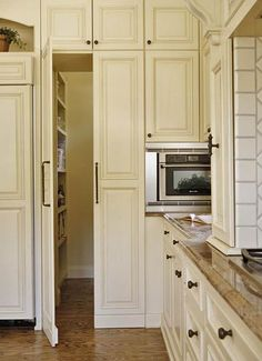 Concealed Pantry Storage              While panels alongside the refrigerator blend in with surrounding cabinets, they are actually doors opening to a hidden walk-in pantry