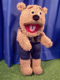 "GOT. REALLY nice bear 15 inch 24. main character. just generally friendly, happily, slightly stupid guy. always upbeat. his dog (with the tie) also talks sometimes (but less), acts as dog. somewhat stupider and more enthusiastic with less words (the dog). pluto/goofy. this is dog-bear ala fozzie. 14"" ""silly bear"" from ""Silly Puppets"""