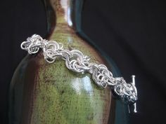 Celtic Lace Chain Maille Bracelet $28.00 at Dancing Leaf Studios.  So much great chain maille jewelry!!