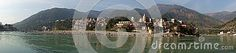A panoramic image of the Lakshman Jhula village along the shores of the ganges river in the foothills of the Himalayas in Rishikesh Uttarakhsnd India Panoramic Images, Rishikesh, Himalayan, India, River, Stock Photos, Mountains, Goa India, Himalayan Cat