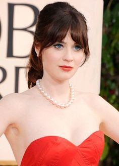 Zooey Deschanel: A ponytail and pearls—a surprisingly magical combination.