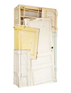 Chris Ruhe has created storage cabinets from old doors and cabinets giving them a new life as one big cabinet.