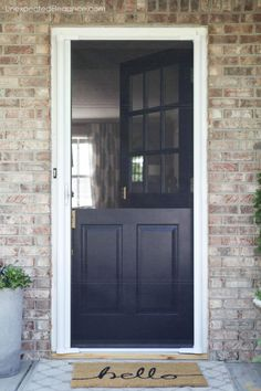 Looking for a cost-effective screen for you Dutch door??  Check out this inexpensive and DIY friendly solution!!  #frontdoor #exterior