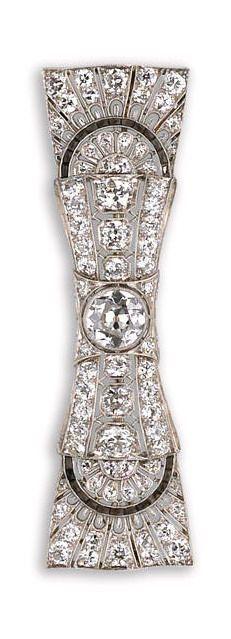 An art deco diamond brooch, Black, Starr & Frost, circa 1930 of bow