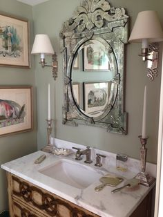 stone top vanity, venetian mirror, sconces. like the artwork placement on the side wall