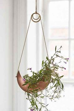 """Magical Thinking Crescent Hanging Planter $24 Metal hanging planter designed exclusively for Urban Outfitters as part of the bohemian Magical Thinking collection. Crescent-shaped design for displaying your favorite plants in a unique way. Looks great in any living space, but we love it near a window. Only at UO!  Content + Care - Metal - Wipe clean - Imported  Size - Length: 8"""" - Width: 3.5"""" - Height: 14"""""""