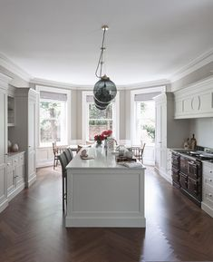 The AGA is the central feature of the Flourish. Nestled underneath a dramatic canopy, it is flanked by elegantly framed furniture.
