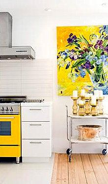 love the splashes of color on the white backdrop, the grouping of colored glass candlesticks, the beautiful painting