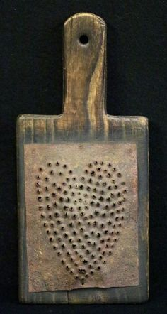 Grater w/Heart Motif. Early grater with a heart pattern, tin and wood. The tin grater is attached to a chestnut board with a handle to facilitate easy use. An interesting piece of folk art. Primitive Furniture, Primitive Antiques, Primitive Crafts, Country Primitive, Primitive Bedroom, Primitive Homes, I Love Heart, Happy Heart, Humble Heart