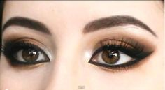 copper eye shadow with black eyeliner and mascara with a little bit of champagne eye shadow at the inner corner