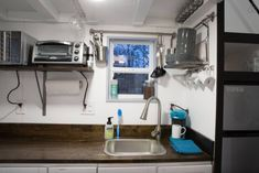 #WhyILikeThisIdea - the faucet for the kitchen sink is off set to accommodate the smaller cabinets - great idea!