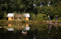 Located in the Netherlands, this is one shed that's too pretty to store the shovels. Designed and built by Caspar Schols, the transforming, multipurpose space overlooks a pond in his parents' backyard.