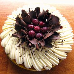 Black Forest Tart - layers of rich chocolate ganache and tart & brandied cherries in a Kirsch-infused chocolate bottomed flaky pastry crust, topped with vanilla bean-crème fraîche chantilly, and garnished with dark chocolate curls and tart & brandied cherries!