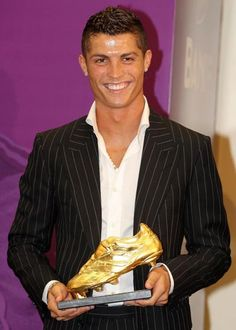 Cristiano Ronaldo with, what we assume, player of the year award?