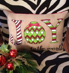 Darling Joy pillow. Dress up your couch with this cute Christmas Pillow! Back is red cotton. Pillow insert is 12x16. It may measure just a bit smaller as I want the insert to fit tightly. This pillow can be painted in any color. Just message me for options. Get into the Christmas Spirit and add this to your Christmas décor.