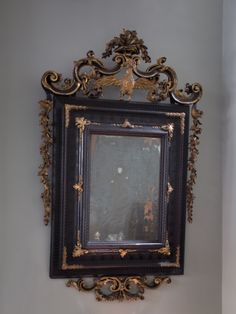 A Fine Early 18th Century Venetian Ebonised & Parcel Gilt Mirror. -