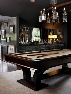 """Eclectic Game Room with Built-in bookshelf, African antelope """"thomson's gazelle"""" shoulder mounted taxidermy, Chandelier"""