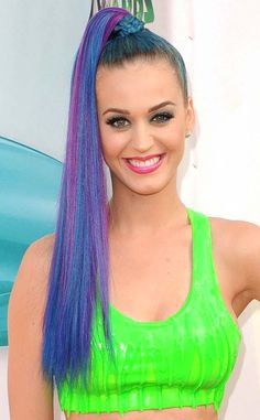 2012 from Katy Perry's Hair Through the Years  The singer went for an I Dream of Jeannie-meets-teenage raver look at the Nickelodeon Kids Choice Awards with a blue and purple high ponytail. And she didn't stop there! Blue eye shadow and pink lips completed the look.