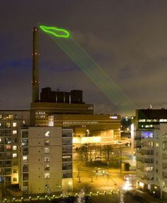 Green Cloud by Helen Evans and Heiki Hansen. Every night for one week in 2008, a green laser brought attention to the noxious emissions from the Salmisaari coal burning power plant in Helsinki.