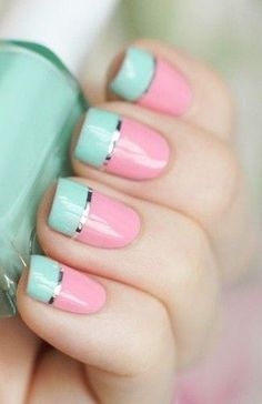 Cute baby pink and sea green polish with silver metallic strips as linings for the French tips.