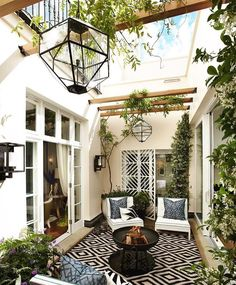 """Kate Abt Design on Instagram: """"How gorgeous is this interior courtyard by London designer Helen Green @hgdstudio? Such a fun space. Beautiful glass ceiling making the…"""""""