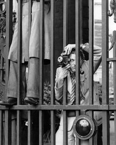 A photographer on the eve of Queen Elizabeth II's coronation, Admiralty Arch London, 1 June 1953 by Bob Collins. London Pictures, London Photos, Love Photography, Black And White Photography, Social Photography, Vintage Photography, London Street Photography, London Museums, Black N White Images