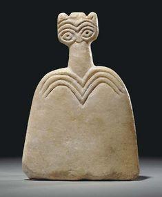 """Syrian marble """"Eye"""" idol, 4th millenium B.C"""