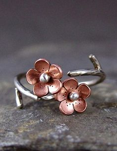 A delicate copper and silver ring preserves the loveliness of cherry blossom season. #etsyjewelry