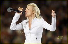 Carrie Underwood performs during the pregame show prior to Super Bowl XLIV between the Indianapolis Colts and the New Orleans Saints on February 2010 at Sun Life Stadium in Miami Gardens, Florida. Carrie Underwood Engagement Ring, Sun Life Stadium, Carrie Underwood Photos, Singing The National Anthem, Country Singers, Super Bowl, New Orleans, Carry On, Off The Shoulder