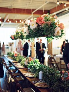 Hanging arrangments over estate tables or guest tables. HUGE impact. Lots of greenery and pretty flowers!!!