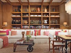 Nice Living Area. Love The Long Couch And The Bookcases......