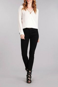 Criss-Cross Overlap Blouse pairs perfect with black or denim jeans for a casual look pair with sandals. For more of a dressy look pair with heels to complete the look. Criss-Cross Overlap Blouse by Blu Pepper. Clothing - Tops New Jersey