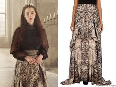"In the episode 2x11 (""Getaway"") Queen Mary wears a Roberto Cavalli Printed Monochrome Skirt."
