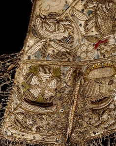 Pair of gloves (England) ca. 1603 - 1625 Leather and satin, embroidered with silk and metal thread, spangles and seed pearls