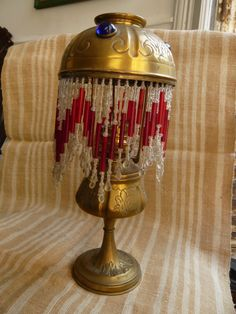 "antique french brass oil lamp called""La Parisienne"" with shade and beads,end 19th,early 20th"
