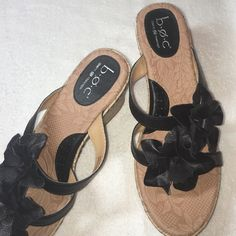 Born Wedge Sandals This pair of Born Wedge Sandals are black leather uppers they have strap between your big toe and second toe and have two black leather flowers decorating the top  were not worn much as you can see I the pictures troops and soles show little wear.  In excellent condition they are a size 9 Born Shoes Sandals