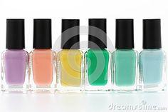 Nail polish bottles rainbow on white background