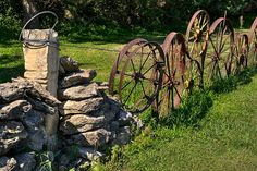 rusty wagon wheel fence ~beautiful