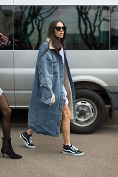 Long denim coat.