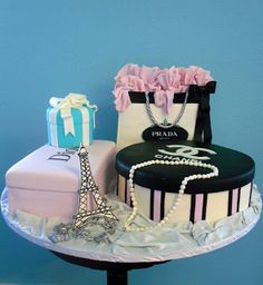 paris themed birthday cakes -pearls and Chanel no 5 perfume.