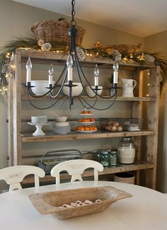 I love the shelving...looks like it could be a diy project.  blog has GF recipes too.  quaint decorating style