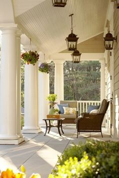 White porch with pillars and lanterns